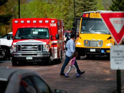 Students are evacuated from the Recreation Center at Northridge in Highlands Ranch after a shooting at the STEM School Highlands Ranch on May 7, 2019. - At least seven students were wounded on May 7 in a school shooting in the US state of Colorado, police said, across town from …