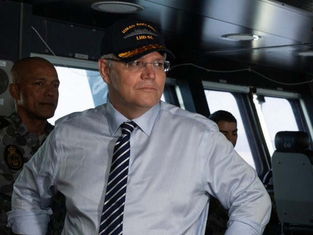 Prime Minister of Australia, the Hon Scott Morrison, MP, is shown the bridge of HMAS Adelaide by Commanding Officer, Captain Jonathan Earley, CSC, RAN, during a visit to personnel deployed in support of APEC in Port Moresby, Papua New Guinea, onboard Royal Australian Navy amphibious ship, HMAS Adelaide.