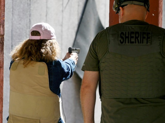 In this Saturday, June 29, 2019, photo, Cindy Bullock, Timpanogos Academy secretary, participates in shooting drills at the Utah County Sheriff's Office shooting range during the teacher's academy training, in Spanish Fork Canyon, Utah. About 30 teachers in Utah are spending their summer learning how to stuff wounds and shoot …