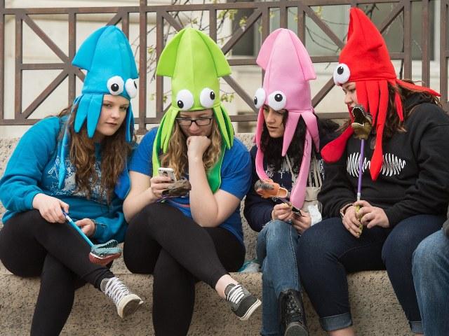 teenagers look at phone