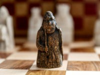 LONDON, ENGLAND – JUNE 3: A newly discovered Lewis Chessman at Sotheby's on June 3, 2019 in London, England. On 2 July in London, Sotheby's will offer the first discovery of an unknown missing piece from the hoard of 93 objects found in 1831 on the Isle of Lewis in …