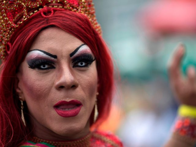 A drag queen poses for the picture during the Gay Pride Parade at Copacabana beach in Rio de Janeiro, Brazil, on November 19, 2017. / AFP PHOTO / LEO CORREA (Photo credit should read LEO CORREA/AFP/Getty Images)