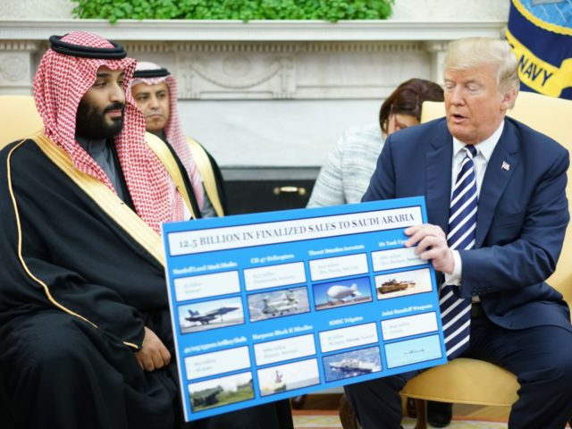 TOPSHOT - US President Donald Trump (R) holds a defence sales chart with Saudi Arabia's Crown Prince Mohammed bin Salman in the Oval Office of the White House on March 20, 2018 in Washington, DC. (Photo by MANDEL NGAN / AFP) (Photo credit should read MANDEL NGAN/AFP/Getty Images)