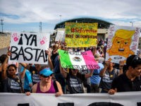 "People gather outside a border crossing to protest the treatment of immigrants in detention centers during the ""Lights for Liberty: A Vigil to End Human Concentration Camps"" event in El Paso, Texas, on July 12, 2019. - The march is occurring in at least 11 major US cities among 700 …"