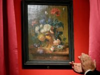 "The ""Vase of Flowers"" painting by Jan van Huysum, is unveiled during a ceremony at the Pitti Palace, part of the Uffizi Galleries, in Florence, Italy, Friday, July 19, 2019. Germany returned the Dutch still-life after it was stolen by Nazi troops during WWII. (AP Photo/Gregorio Borgia)"
