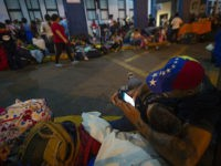 "Venezuelan citizens wait in line to get a refugee application at a Peruvian border post at the binational border attention centre (CEBAF) in Tumbes on June 13, 2019. - ""Between 11 and 12 June, more than 6,000 Venezuelans have entered the national territory,"" said Wilmer Dios, governor of the northern …"