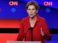 Democratic presidential hopeful US Senator from Massachusetts Elizabeth Warren (R) speaks next to US senator from Vermont Bernie Sanders during the first round of the second Democratic primary debate of the 2020 presidential campaign season hosted by CNN at the Fox Theatre in Detroit, Michigan on July 30, 2019. (Photo …