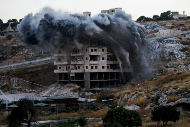 A building which was under construction in the Palestinian village of Sur Baher in East Jerusalem is demolished on July 22, 2019