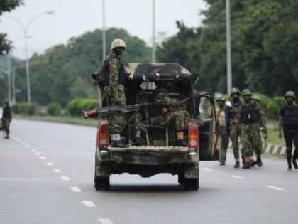 Soldiers aboard a truck patrol during a violent protest by Shiite Muslims demanding the release of their detained leader Ibrahim Zakzaky on July 23, 2019 in Abuja. At least eight people were killed in clashes between Shiite Muslim protesters and Nigerian police in Abuja on July 22; and a Nigerian …