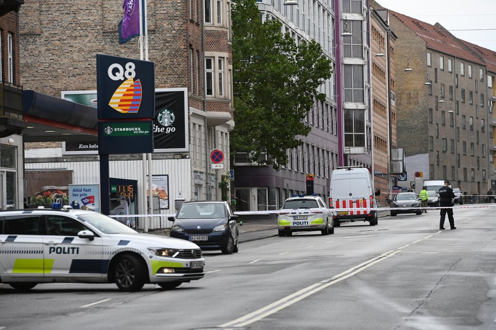 Danish police block a road in a neighborhood of Copenhagen, Saturday, Aug. 10, 2019 after a nearby local police station was hit by an explosion early in the morning. This follows-on from Tuesday's explosion which occurred outside the Danish Tax Agency's office in Copenhagen. (Philip Davali/Ritzau Scanpix via AP)
