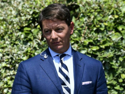 White House deputy press secretary Hogan Gidley walks past reporters after doing a television interview at the White House in Washington, Tuesday, Aug. 20, 2019. (AP Photo/Susan Walsh)