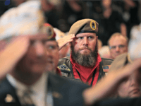 LOUISVILLE, KENTUCKY - AUGUST 21: Veterans salute for the presentation of colors during the Joint Opening Ceremony at the American Veterans (AMVETS) 75th National Convention at the Galt House where President Donald Trump is expected address the members on August 21, 2019 in Louisville, Kentucky. AMVETS is a non-partisan, volunteer-led …