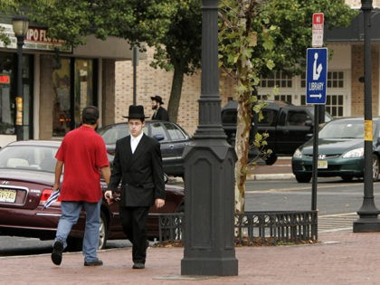 People walk along the main street in Lakewood, N.J., Thursday, Oct. 11, 2007. The beating of 53-year-old Mordechai Moskowitz, a teacher and rabbi in the Jewish community, has raised tensions in the diverse community of Lakewood that is home to a large Orthodox Jewish population as well as black and …