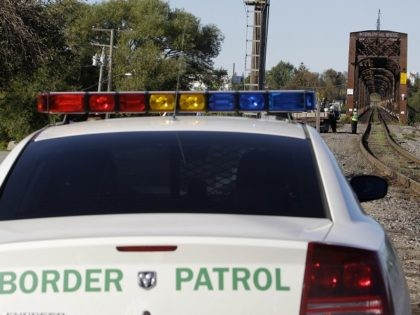 In this Oct. 6, 2011 photo, Senior Border Patrol Agent Sheldon Cooper monitors the International Railroad Bridge in Buffalo, N.Y. In a move that is supposed ease an overburdened immigration system, U.S. Border Patrol field offices around the country have been told to stop the controversial practice of routinely searching …