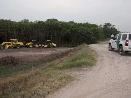 In this April 29, 2019, photo, construction equipment sets in an area of demolished trees and brush where construction is set to begin soon, in Mission , Texas. The cleared area included a mix of trees, including mesquite, mulberry and hackberry, used to protect birds during the ongoing nesting season. …