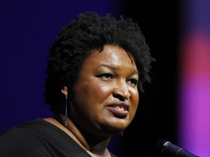 Former Georgia House Minority Leader Stacey Abrams addresses the 110th NAACP National Convention, Monday, July 22, 2019, in Detroit. (AP Photo/Carlos Osorio)