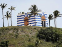 A blue-striped structure sits on a lookout point on Little St. James Island, in the U. S. Virgin Islands, a property owned by Jeffrey Epstein, Wednesday, Aug. 14, 2019. Epstein bought Little St. James Island more than two decades ago and built a stone mansion with cream-colored walls on one …