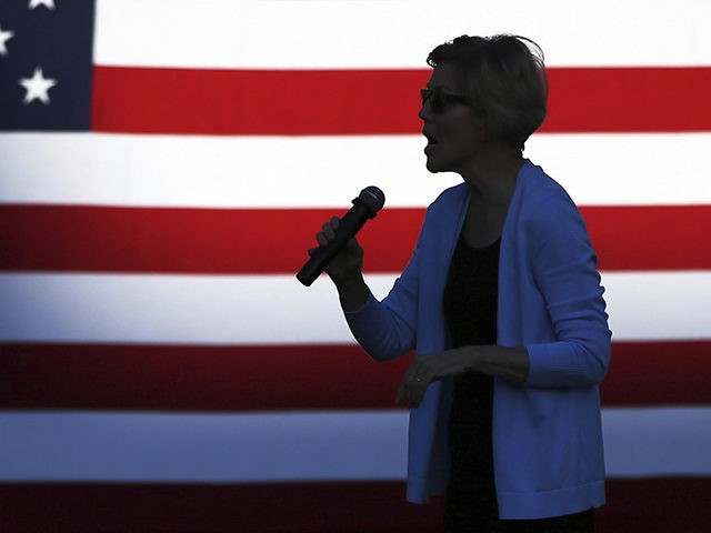 Democratic presidential candidate Elizabeth Warren, D-Mass., is silhouetted as she speaks during a rally Monday, Aug. 19, 2019, at Macalaster College during a campaign appearance in St. Paul, Minn. (AP Photo/Jim Mone)