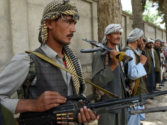 "Afghanistan-unrest-militias,FOCUS by Anuj Chopra This photograph taken on May 23, 2015, shows Afghan militia forces as they stand with their weapons in Kunduz. The commander known as Pakhsaparan, or the ""wall breaker"", barked out commands at his bandolier-draped fighters, part of a patchwork of anti-Taliban militias in northern Afghanistan seeking …"