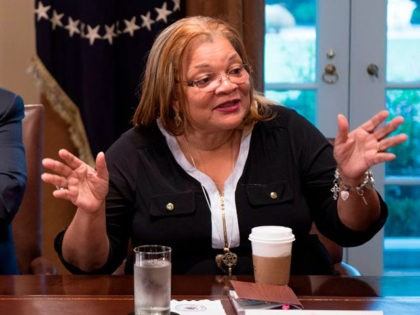 US President Donald Trump listens to Dr. Alveda King, niece of Dr. Martin Luther King Jr., during a meeting with inner city pastors at the White House in Washington, DC,on August 1, 2018. - President Trump delivered remarks at the roundtable discussion with several inner city pastors, and discussed the …
