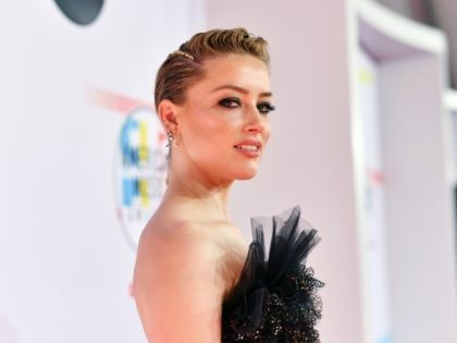 LOS ANGELES, CA - OCTOBER 09: Amber Heard attends the 2018 American Music Awards at Microsoft Theater on October 9, 2018 in Los Angeles, California. (Photo by Emma McIntyre/Getty Images For dcp)