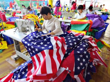 Chinese employees sew U.S. flags at a factory in Fuyang in China's eastern Anhui province on July 13, 2018. #