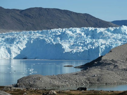 EQIP SERMIA, GREENLAND - AUGUST 01: The Eqip Sermia Glacier, also called the Eqi Glacier, is seen behind a moraine left exposed by the glacier's retreat during unseasonably warm weather on August 01, 2019 at Eqip Sermia, Greenland. Eqip Sermia is located approximately 350km north of the Arctic Circle, and …