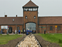 In this photo taken May 1, 2008 during the annual March of the Living, the entrance to the Aushwitz Birkenau former death camp is seen. Germany pledged 60 million euro, or $87 million to a new endowment for Auschwitz-Birkenau to preserve the barracks, gas chambers and other evidence of Nazi …