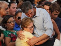 EL PASO, TEXAS - AUGUST 07: Democratic presidential candidate and former Rep. Beto O'Rourke (D-TX) (C-R) hugs a woman at a makeshift memorial outside Walmart honoring victims of a mass shooting there which left 22 people dead, on August 7, 2019 in El Paso, Texas. President Donald Trump visited the …