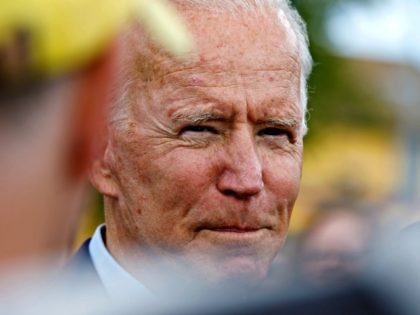 Democratic presidential candidate former Vice President Joe Biden speaks with reporters after a campaign stop at Lindy's Diner in Keene N.H., Saturday, Aug. 24, 2019. (AP Photo/Michael Dwyer)