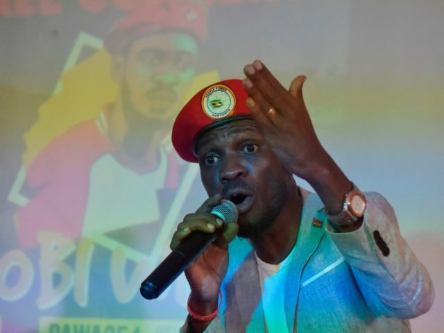 Ugandan pop star turned opposition MP Robert Kyagulanyi, popularly known by pop name Bobi Wine, listens to presentation at the PAWA 254 offices in October 12, 2018, Nairobi, where he met the youth and spoke on several issues affecting the youth in East Africa. (Photo by SIMON MAINA / AFP) …