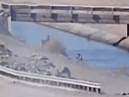 A Border Patrol surveillance camera captures the rescue of a nearly drowning migrant from an irrigation canal in Arizona. (U.S. Border Patrol Surveillance Video Screenshot)