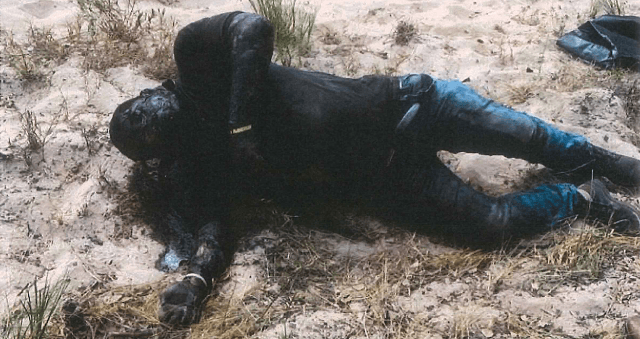 Brooks County Sheriff's Office Deputy Bianca Mora recovers the body of a deceased migrant on a ranch southwest of Falfurrias, Texas. (Photo: Brooks County Sheriff's Office/Deputy Bianca Mora)