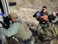 U.S. Border Patrol agents rescue a Guatemalan woman found unresponsive in the Arizona desert Mountains with the assistance of a CBP AMO helicopter aircrew. (Photo: U.S. Border Patrol/Tucson Sector)