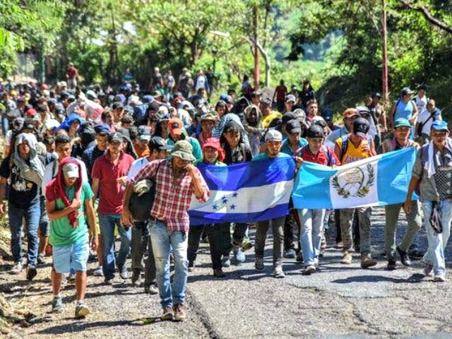 A caravan of migrants traveled through Guatemala en route to the United States on Wednesday.CreditCreditOrlando Estrada/Agence France-Presse — Getty Images