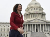 FILE - In this Jan. 4, 2019 file photo, Rep. Cheri Bustos, D-Ill., walks to a group photo with the women of the 116th Congress on Capitol Hill in Washington. A mass departure of top aides is shaking House Democrats' campaign arm after Hispanic and black members of Congress complained …