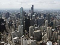 The downtown Chicago skyline, including the Willis Tower, formerly known as the Sears Tower, are seen in this aerial photograph over Chicago, Illinois, May 30, 2013. AFP PHOTO / Saul LOEB (Photo credit should read SAUL LOEB/AFP/Getty Images)