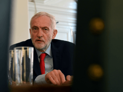 Britain's opposition Labour Party leader, Jeremy Corbyn, poses for a photograph as he prepares to meet with leaders of Britain's other political parties to discuss options for Brexit, in Portcullis House, central London on August 27, 2019. - Labour leader Jeremy Corbyn will on Tuesday attempt to bridge deep divisions …