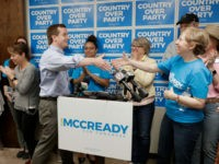 Ninth Congressional district Democratic candidate Dan McCready greets supporters as he arrives for a news conference in Charlotte, N.C., Wednesday, May 15, 2019. McCready faces Republican Dan Bishop, as well as Libertarian and Green candidates, on Sept. 10. (AP Photo/Chuck Burton)