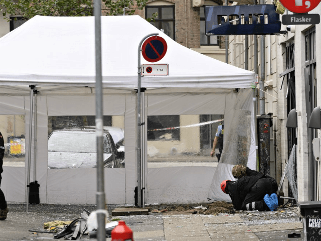 Danish police technicians inspect the scene outside of a local police station in a neighborhood of Copenhagen, Saturday, Aug. 10, 2019 after it was hit by an explosion early morning. This follows-on from Tuesday's explosion which occurred outside the Danish Tax Agency's office in Copenhagen. (Philip Davali/Ritzau Scanpix via AP)