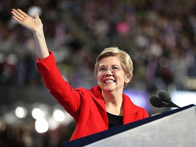 PHILADELPHIA, PA - JULY 25: Sen. Elizabeth Warren (D-MA) acknowledges the crowd as she walks on stage to deliver remarks on the first day of the Democratic National Convention at the Wells Fargo Center, July 25, 2016 in Philadelphia, Pennsylvania. An estimated 50,000 people are expected in Philadelphia, including hundreds …