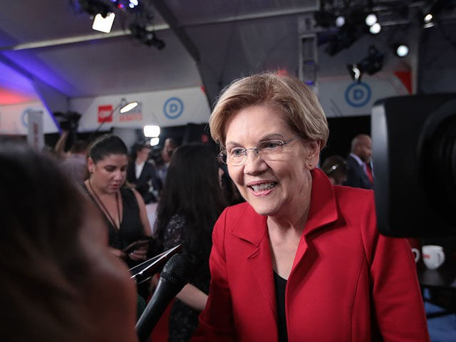 DETROIT, MICHIGAN - JULY 30: Democratic presidential candidate Sen. Elizabeth Warren (D-MA) speaks to the media in the spin room after the Democratic Presidential Debate at the Fox Theatre July 30, 2019 in Detroit, Michigan. 20 Democratic presidential candidates were split into two groups of 10 to take part in …