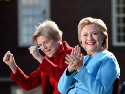 US Democratic presidential candidate Hillary Clinton (R) and Sen. Elizabeth Warren attend a campaign rally October 24, 2016 at Saint Anselm College in Manchester, New Hampshire. / AFP / Robyn BECK (Photo credit should read ROBYN BECK/AFP/Getty Images)