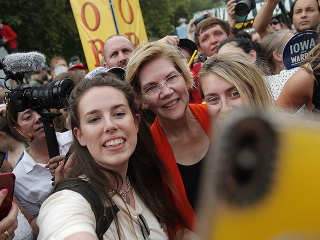 Democratic presidential candidate Sen. Elizabeth Warren, D-Mass., poses for a selfie at the Iowa State Fair, Saturday, Aug. 10, 2019, in Des Moines, Iowa. (AP Photo/John Locher)