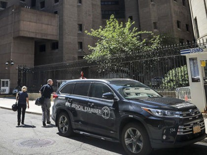 New York City medical examiner personnel leave their vehicle and walk to the Manhattan Correctional Center where financier Jeffrey Epstein died by suicide while awaiting trial on sex-trafficking charges, Saturday Aug. 10, 2019, in New York. He was found in his cell at the Manhattan Correctional Center Saturday morning, according …