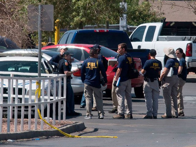 FBI agents check vehicles outside the Cielo Vista Mall Wal-Mart (background) where a shooting left 20 people dead in El Paso, Texas, on August 4, 2019. - Texas authorities are investigating the Saturday mass shooting at a Walmart store in El Paso as a possible hate crime, the city's police …