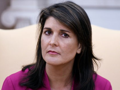Nikki Haley, the United States Ambassador to the United Nations looks on during a meeting with US President Donald Trump speaks in the Oval office of the White House October 9, 2018 in Washington, DC. - Nikki Haley resigned Tuesday as the US ambassador to the United Nations, in the …