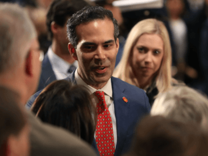 George P. Bush greets mourners in front of the casket of his grandfather the late former President George H.W. Bush as he lies in state in the U.S. Capitol Rotunda, December 4, 2018 in Washington, DC. A WWII combat veteran, Bush served as a member of Congress from Texas, ambassador …