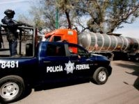 Mexican federal police guard a fuel distribution and storage facility in Guanajuato, Mexico. (File Photo: ULISES RUIZ/AFP/Getty Images)