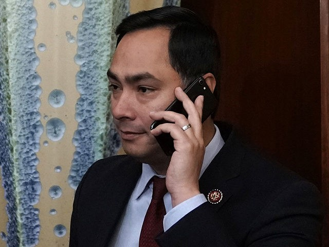 """WASHINGTON, DC - JANUARY 04: U.S. Rep. Joaquin Castro (D-TX) talks on his phone prior to a news conference at the U.S. Capitol January 4, 2019 in Washington, DC. U.S. Speaker of the House Rep. Nancy Pelosi (D-CA) held a news conference to introduce H.R.1, the """"For the People Act,"""" …"""